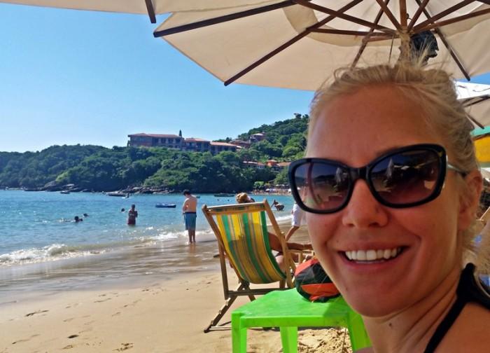 Relaxing under an umbrella in Buzios Brazil