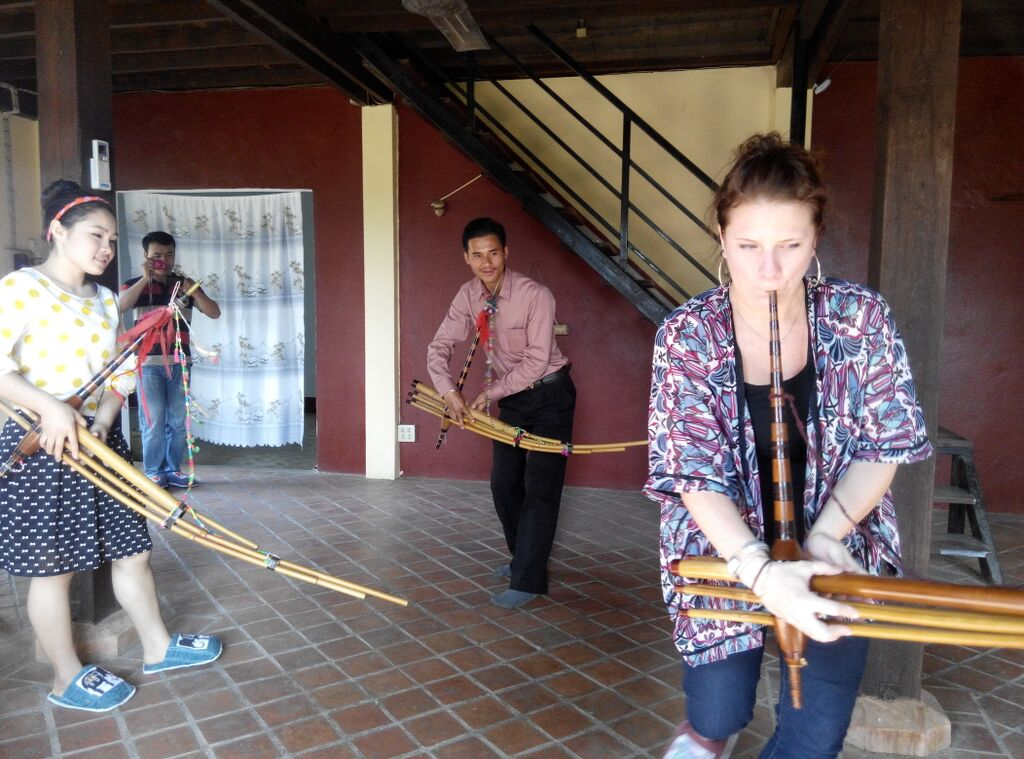 Backstreet academy guests learning about Hmong music in Laos