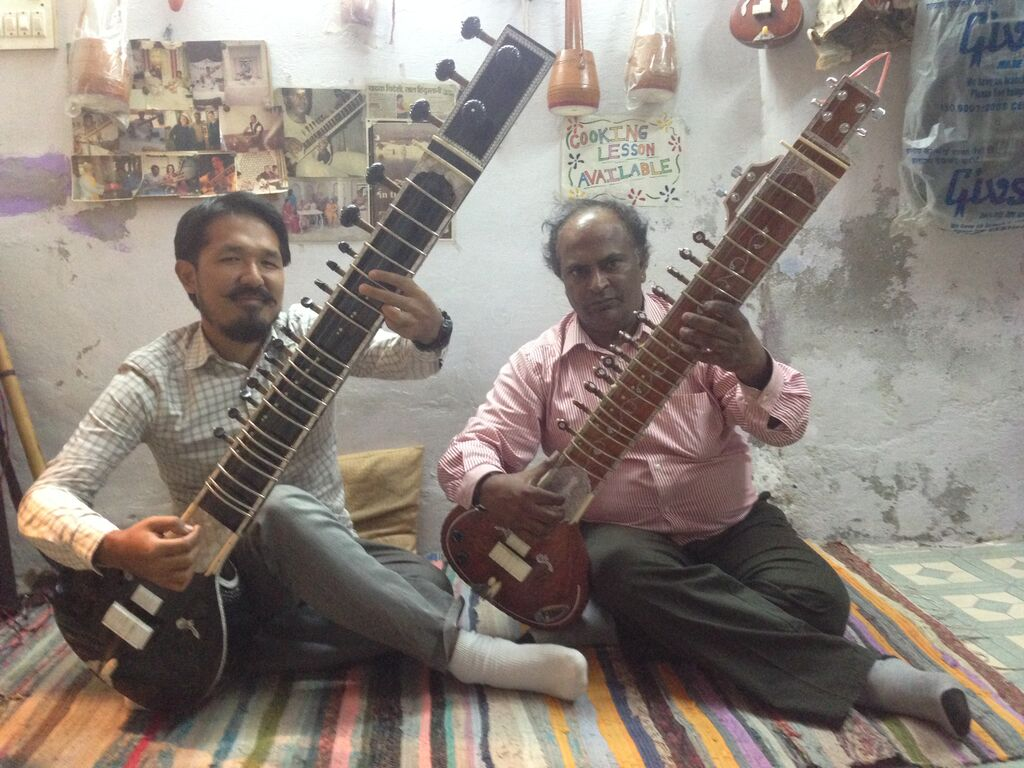 Founder Anil playing sitar