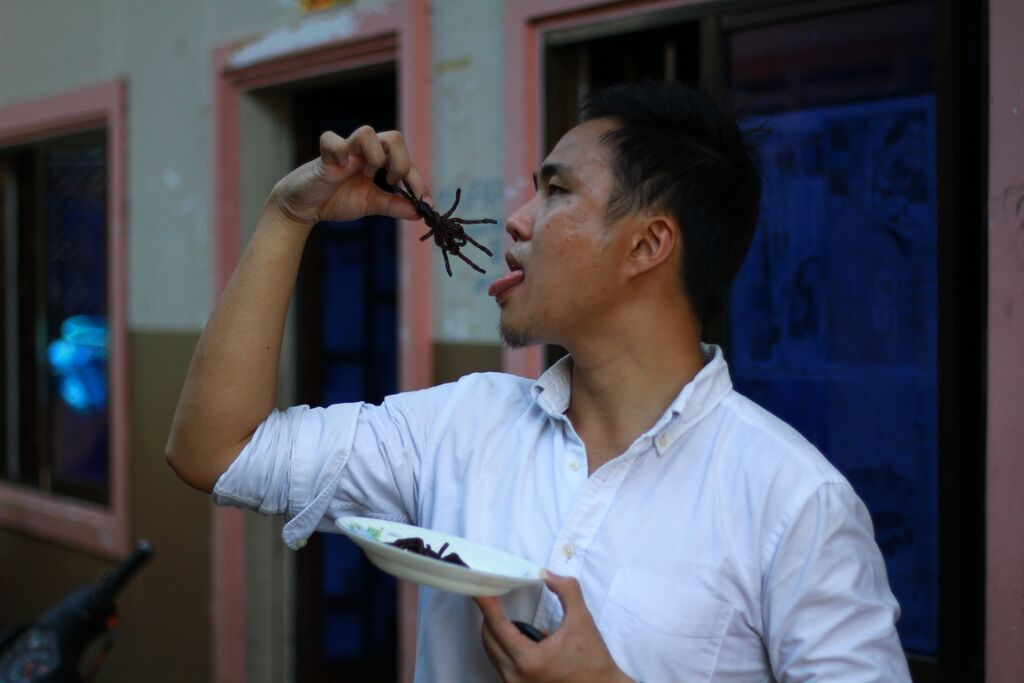 Founder Jamon eating a tarantula
