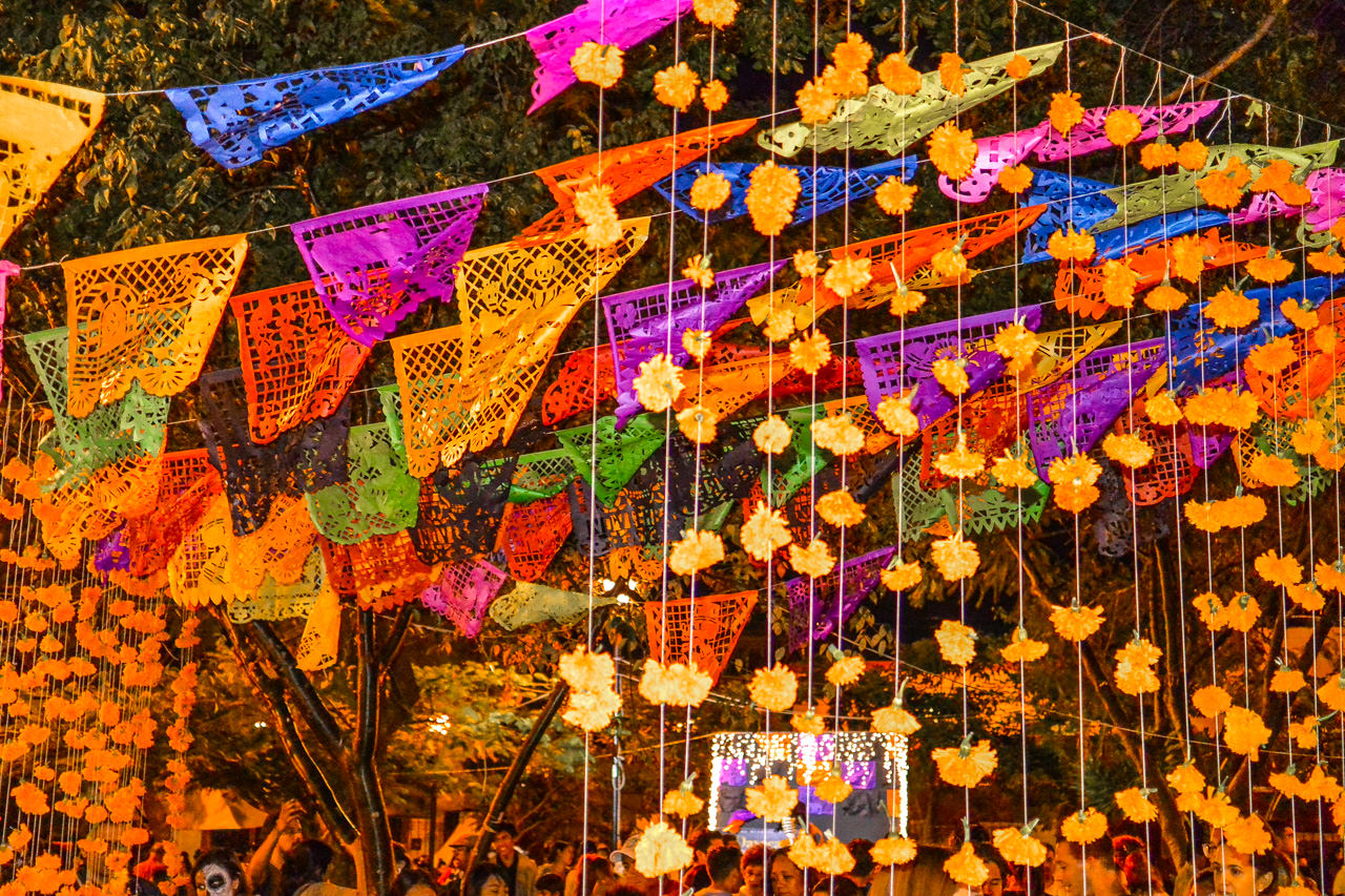 Papel picado (cut paper) flags in Oaxaca church cemetery
